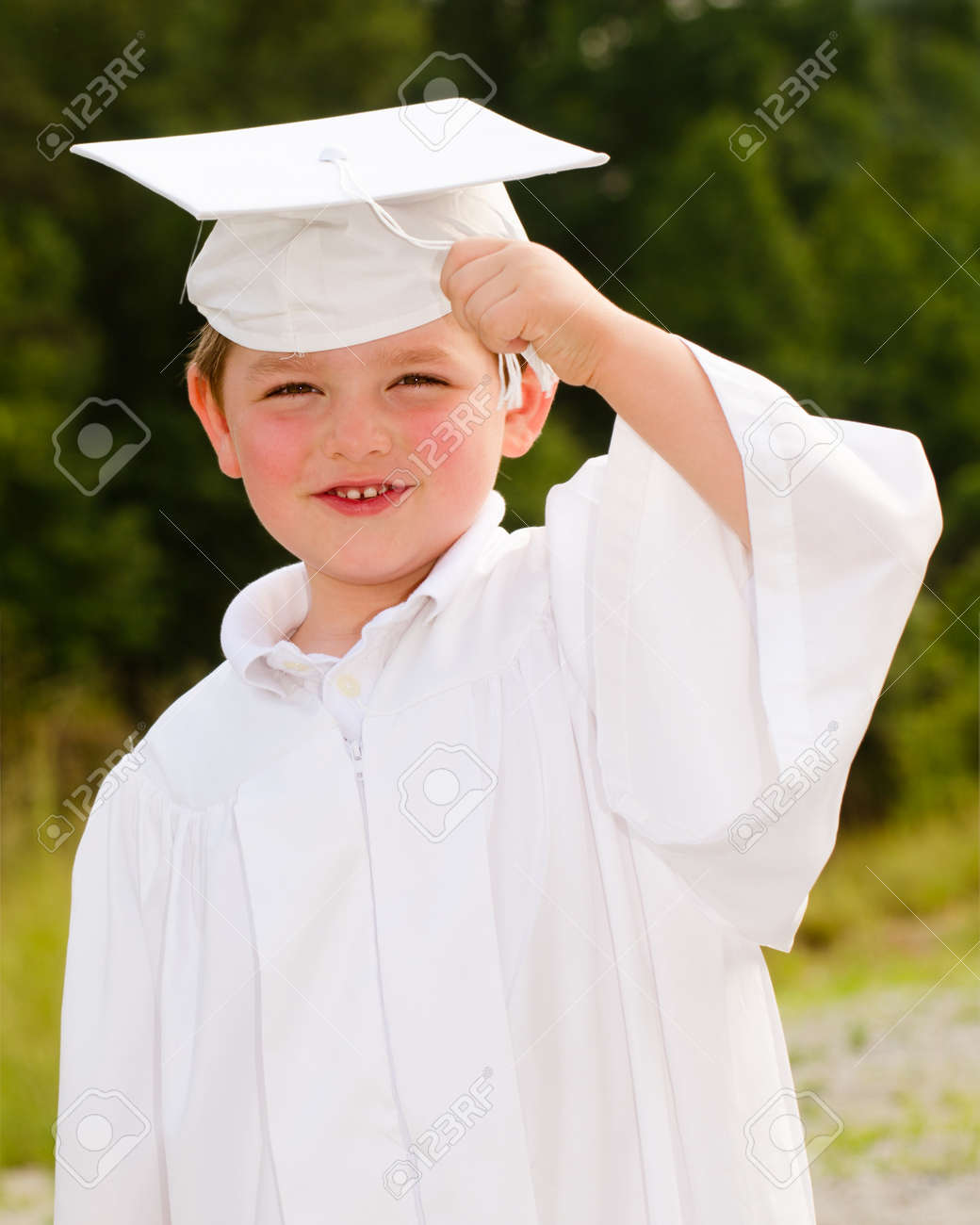 Young Boy With Cap And Gown For Preschool Graduation Stock Photo ...