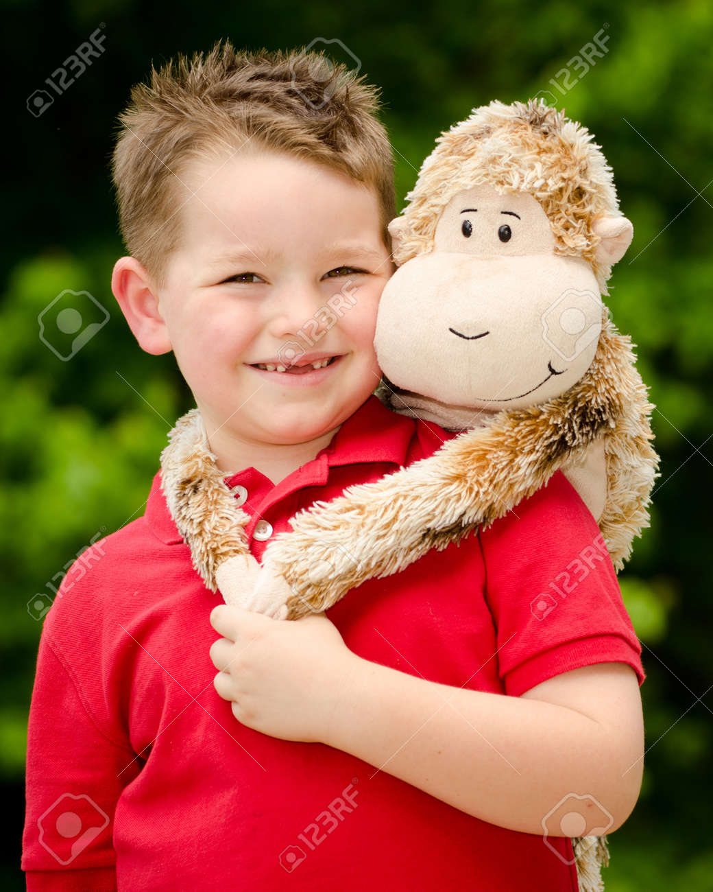 Portrait of boy playing with his stuffed animal pet Stock Photo - 19377324