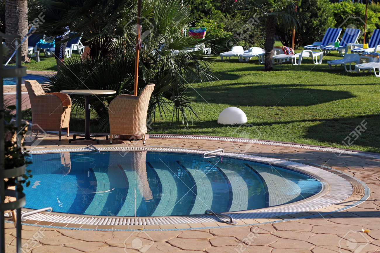 Man cleaning the luxury swimming pool. - 10894245