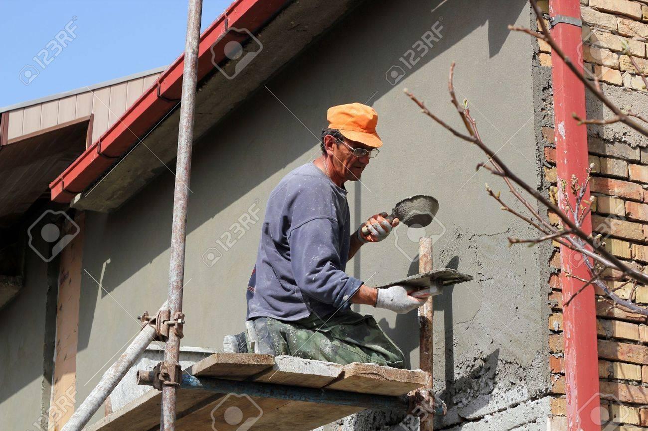 Mature contractor plasterer working outdoors Selective focus - 13275464