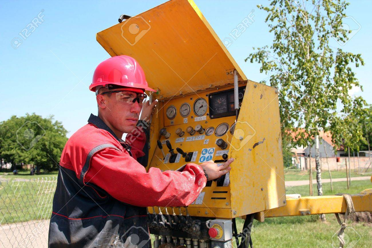 Oil and gas well drilling worker operate drilling rig machinery