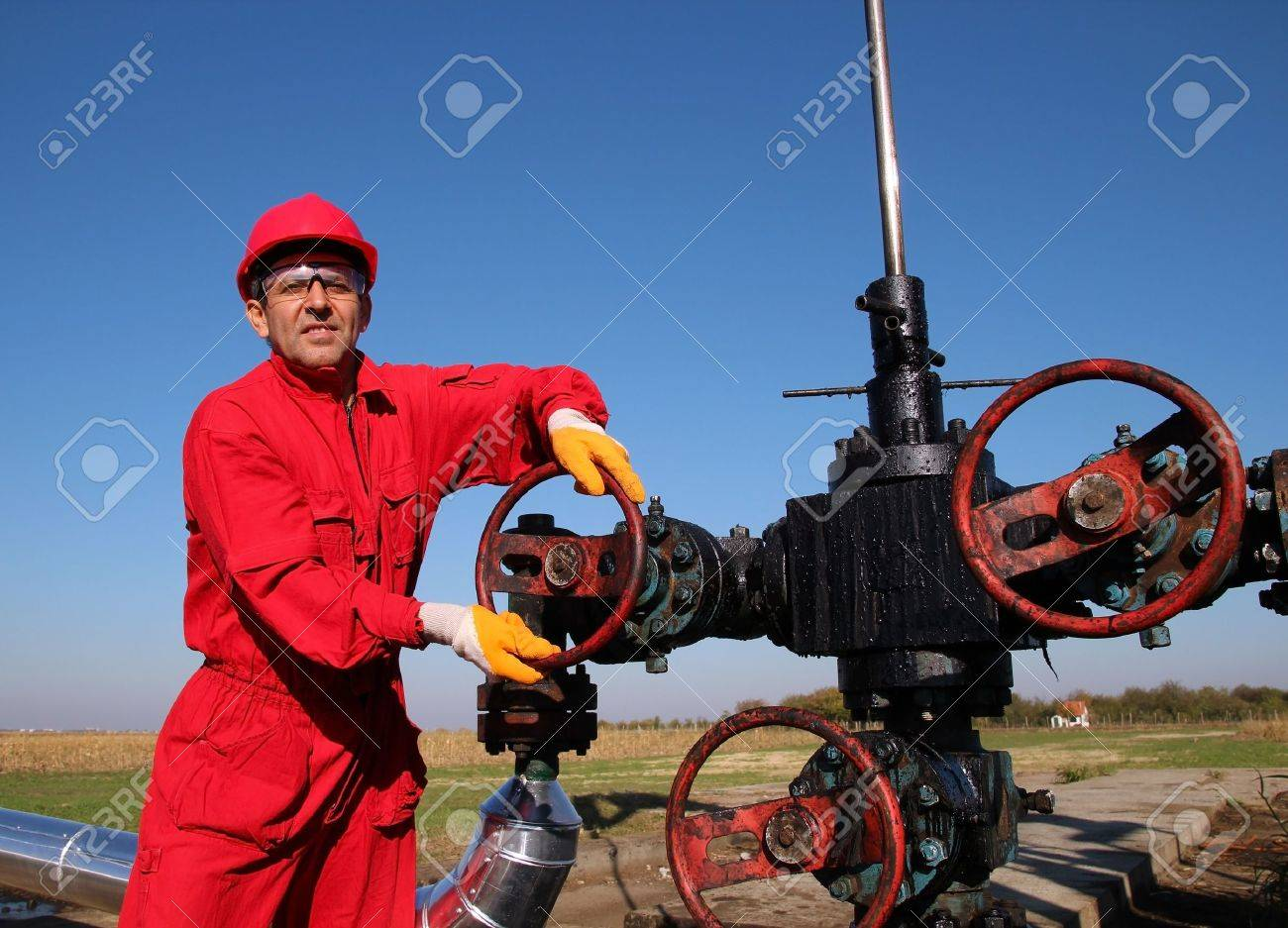 Oil and Gas Worker Wearing Protective Clothing - 18785952
