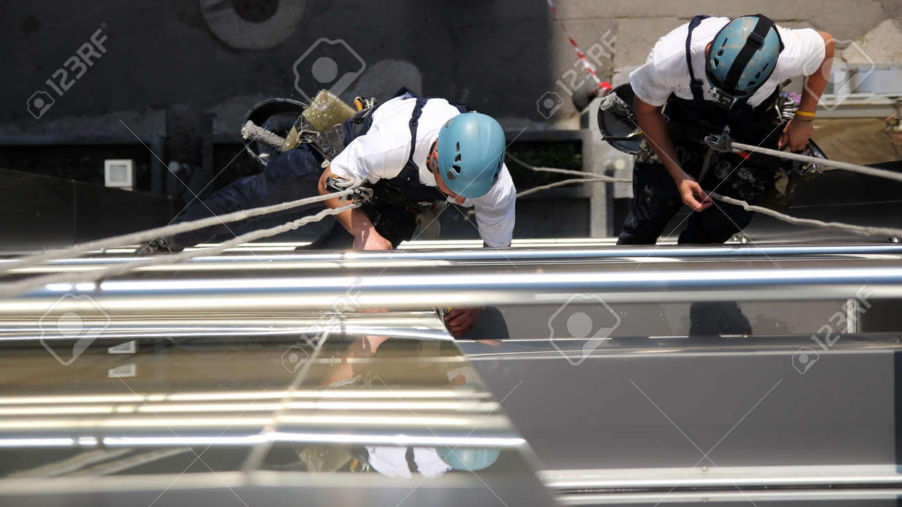 Climbers on Office Building - 26620196