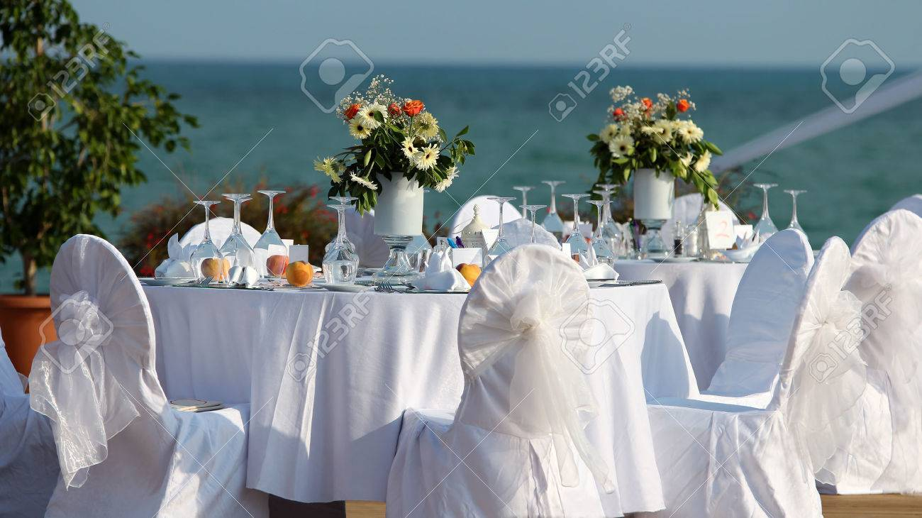 Outdoor Table Setting At Wedding Reception By The Sea Stock Photo