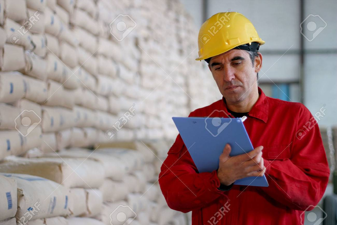 Worker Writing on Clipborad in Warehouse - 32307539