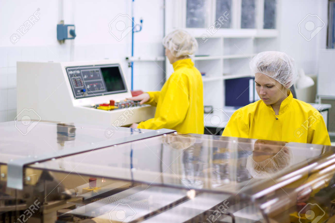 Pharmaceutical Manufacturing Technicians on the Production Line - 33618464