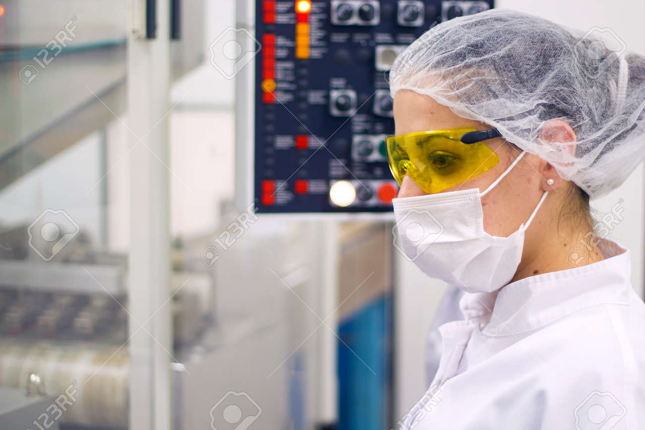 Woman Operating The Control Panel. Pharmaceutical Manufacturing - 33698499