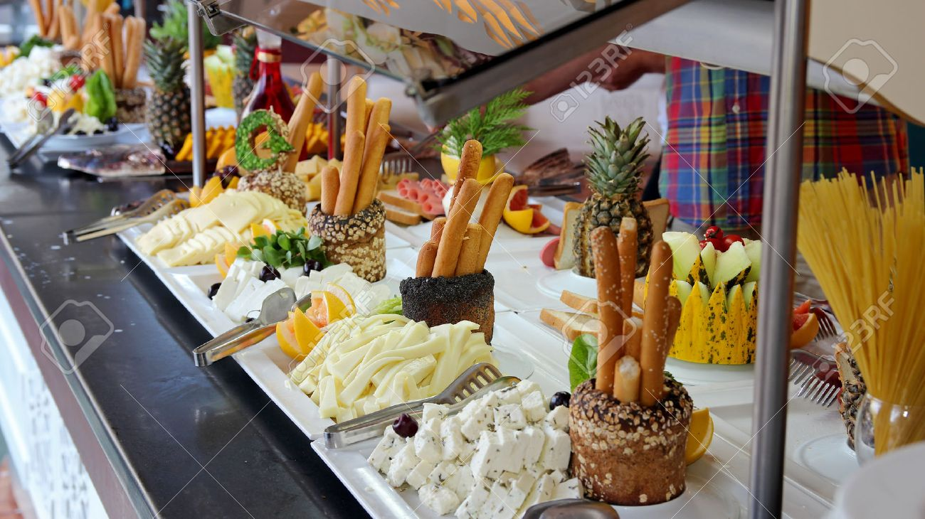 Buffet Catering Food Arrangement on Table.People Serving at Buffet. All inclusive. - 49101578