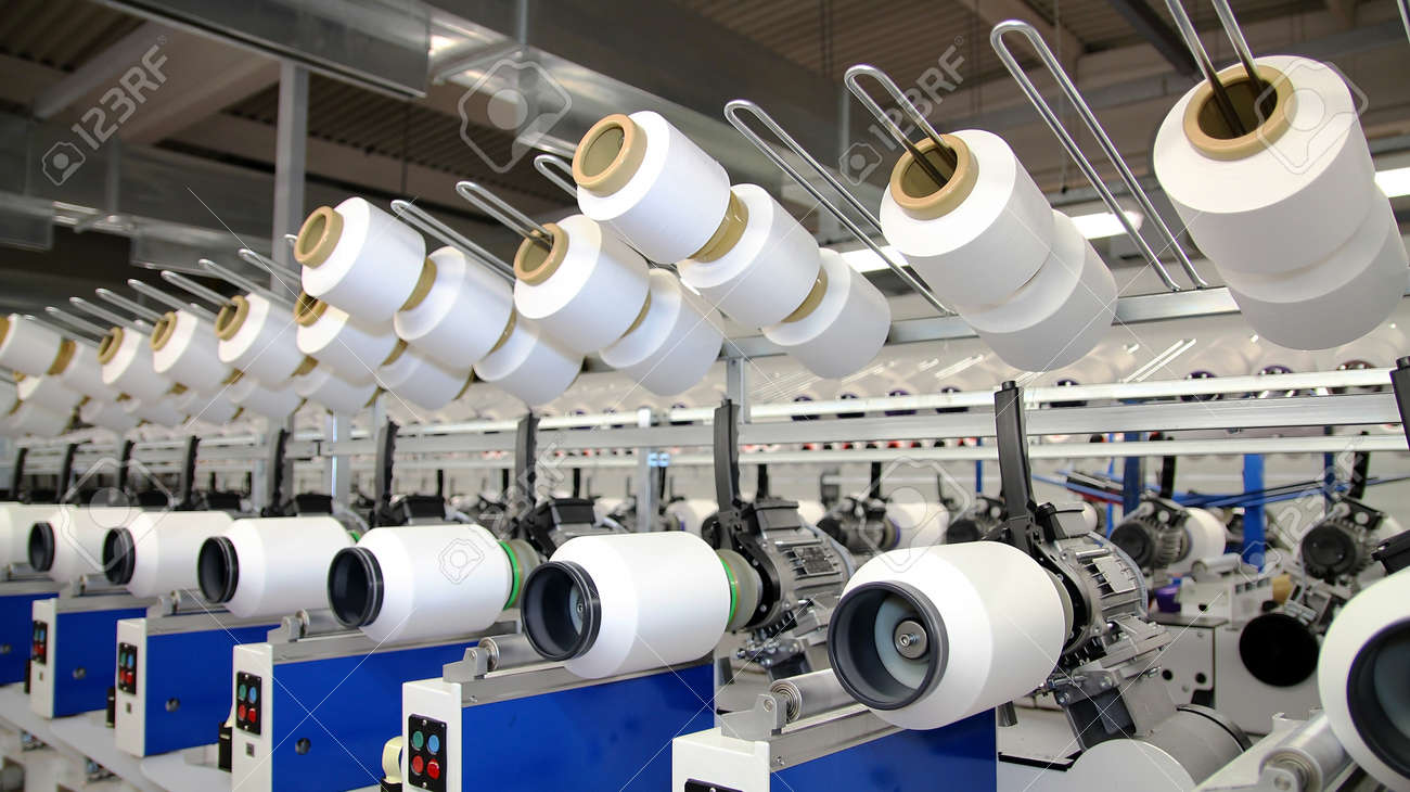 Row of automated machines for yarn manufacturing. Modern Textile Plant. Textile manufacturing of synthetic fibers. - 51246219