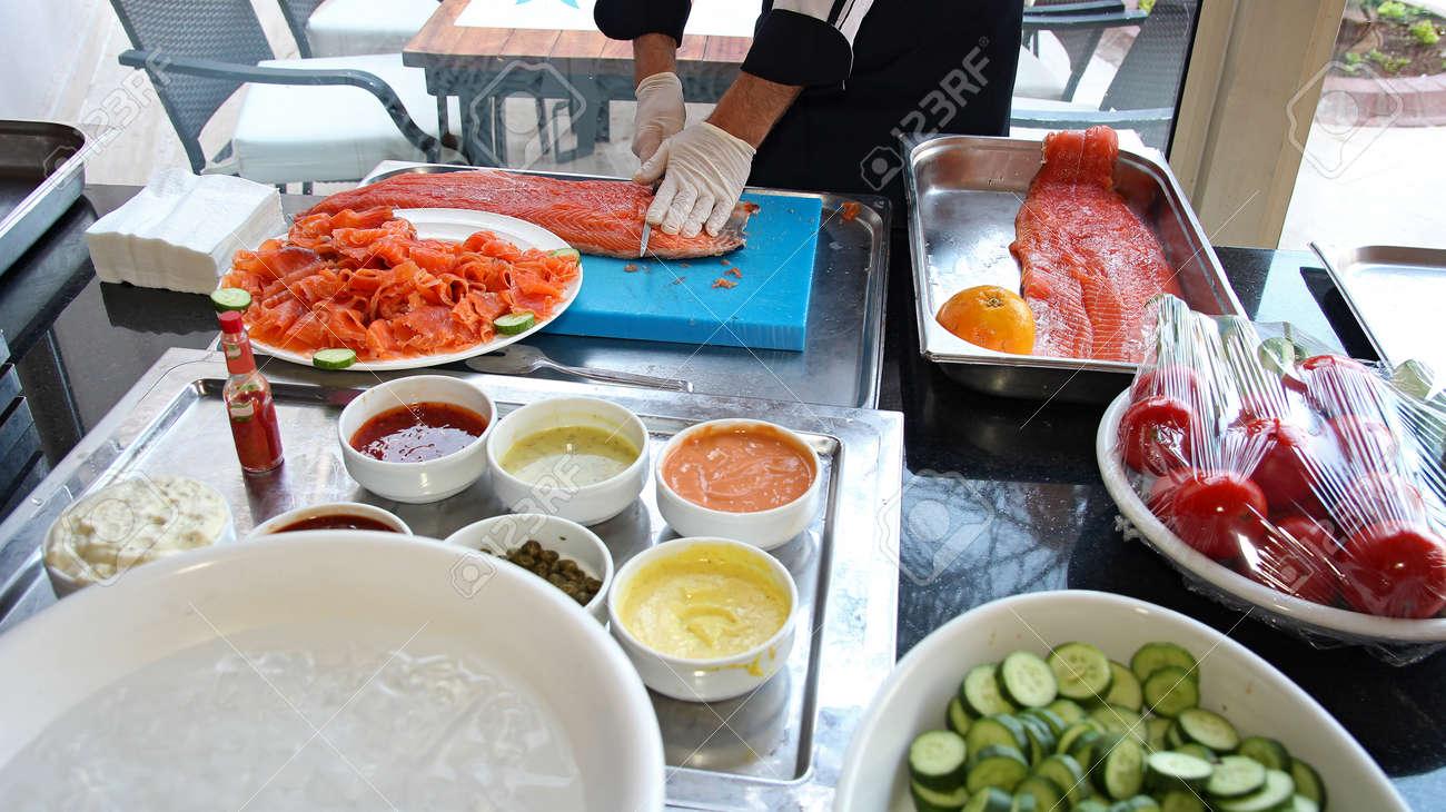 Chef Slicing Smoked Salmon Fish - 54780612