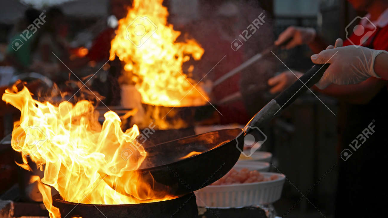 Chef Cooking in Outdoor Kitchen - 55027490