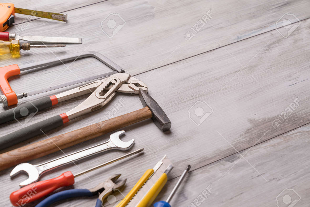 Screwdriver,hammer,tape measure and other tool for construction tools on gray wooden background with copy space,industry engineer tool concept.still-life. - 120433178