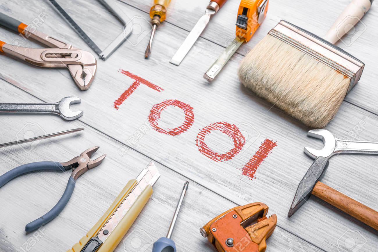 Set of work tools on rustic wooden background with written - 128118718