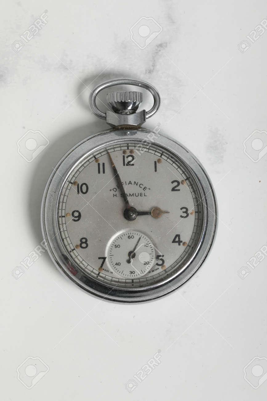 Pocket watch vintage clock . Chrome antique item on white - 147137649