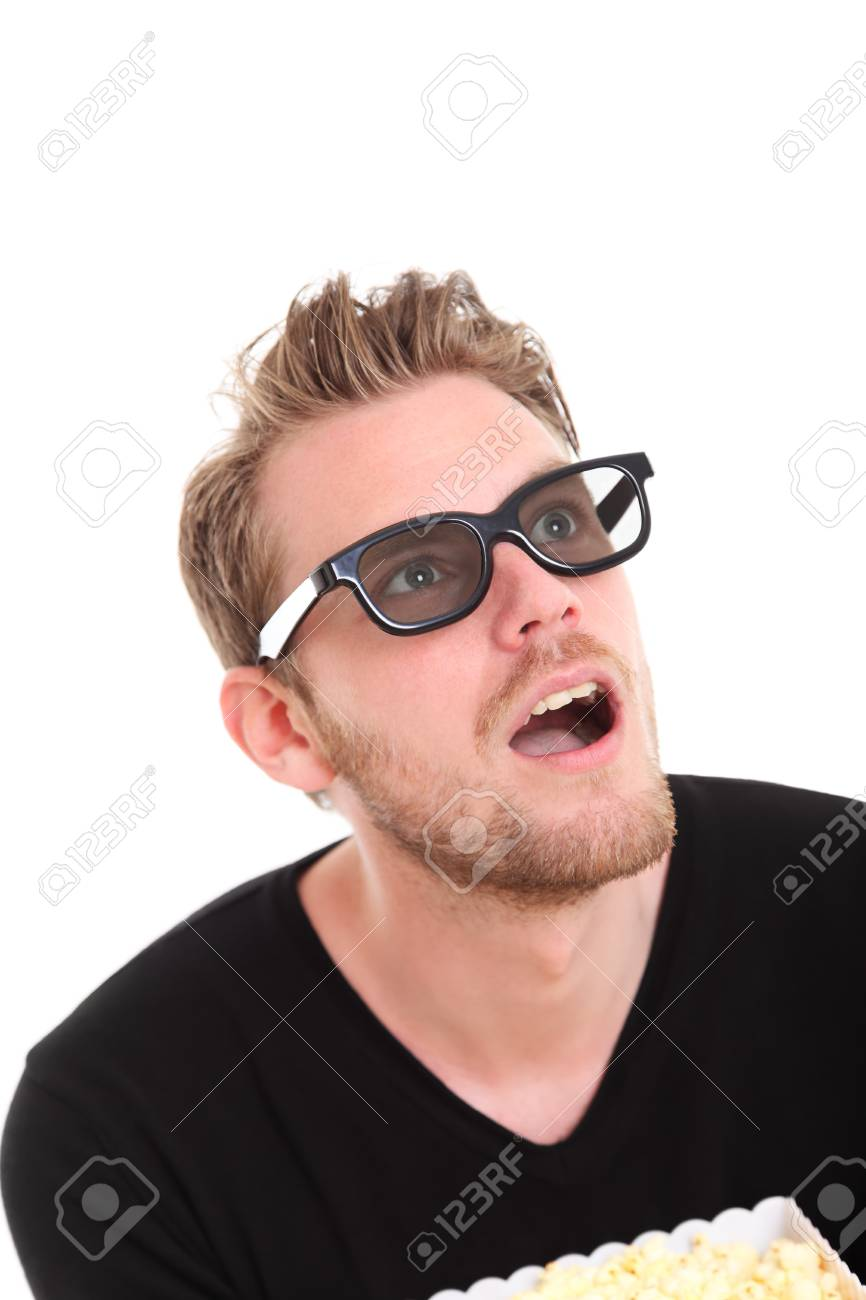 Man in 3D-glasses with a popcorn bucket, sitting down. White background. Stock Photo - 17360479