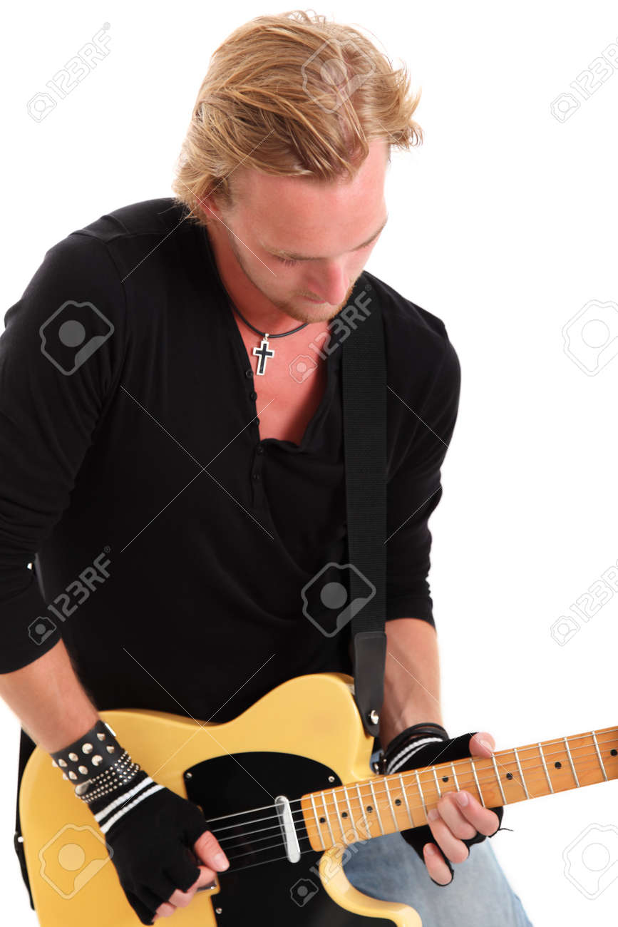 Cool looking rocker with a yellow guitar wearing a black shirt. White background. Stock Photo - 17369875