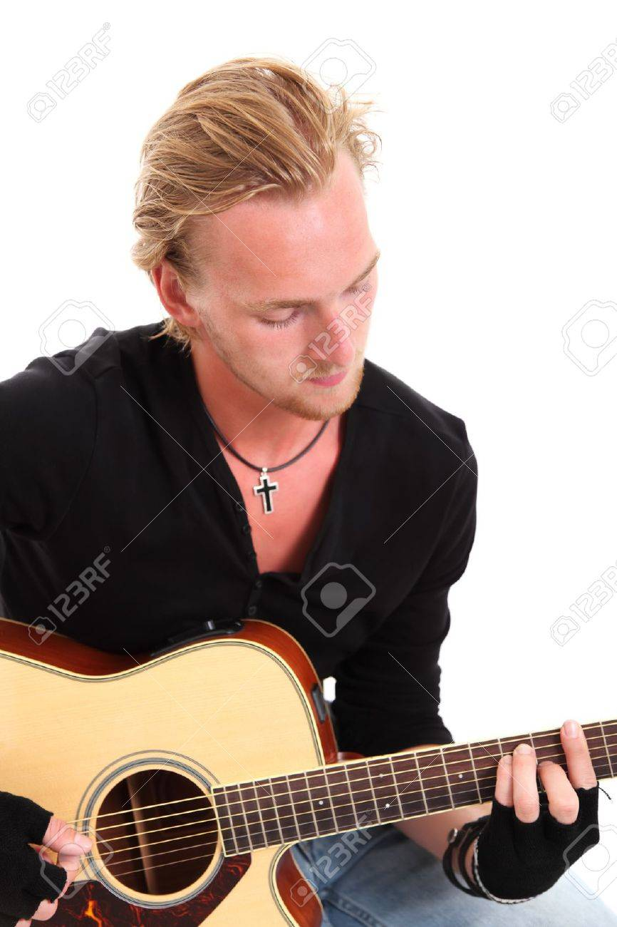 Fingerless gloves for musicians - Stock Photo Young Singer Songwriter Sitting Down With An Acoustic Guitar Wearing Fingerless Gloves And A Black Shirt White Background