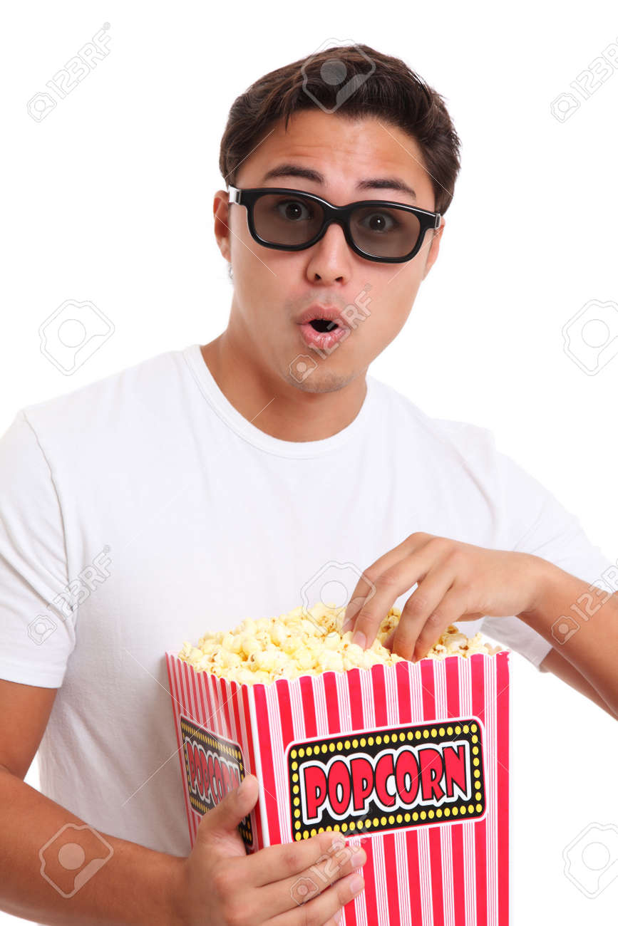 Man in 3d glasses holding a popcorn bucket  Wearing a white t-shirt  White background Stock Photo - 17417119