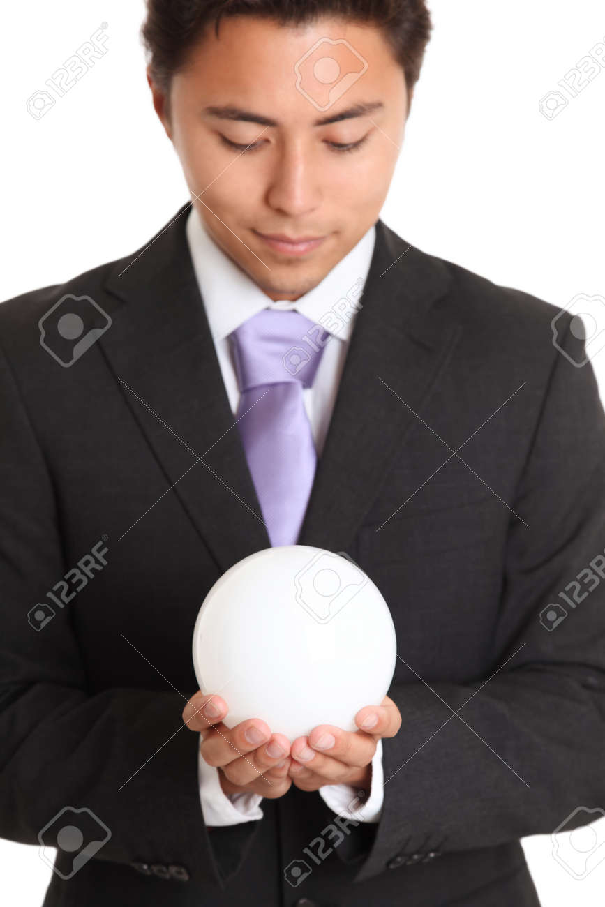 Futures looking bright. Businessman with a glassball, looking in to the future. White background. Stock Photo - 17424675