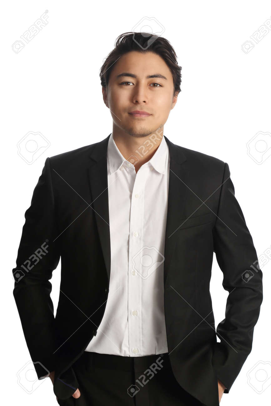 An attractive businessman wearing a black blazer with a white shirt, standing against a white background - 53239842