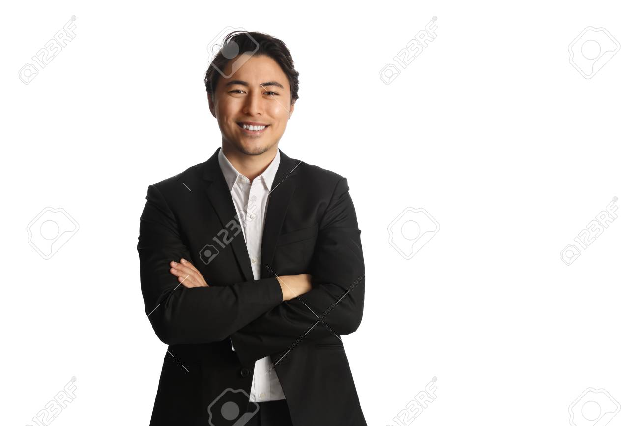 An attractive businessman wearing a black blazer with a white shirt, standing against a white background looking at camera. Smile on his face. - 136716227