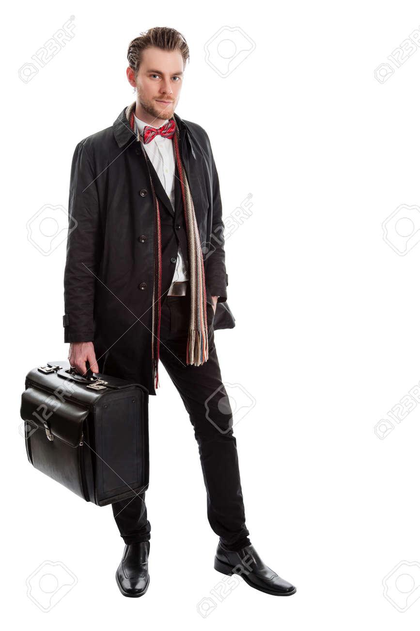 mode de vente chaude en soldes prix raisonnable Homme bien habillé portant un costume et une veste avec un foulard coloré,  debout sur un fond blanc tenant une grande mallette.