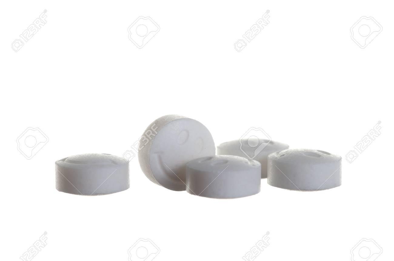 Smiling white pills over white background Stock Photo - 9093164