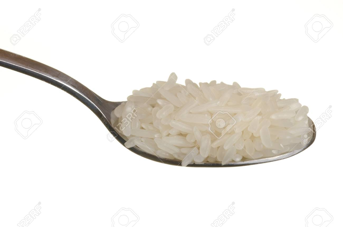 Jasmin rice in a spoon isolated over white background Stock Photo - 11785881
