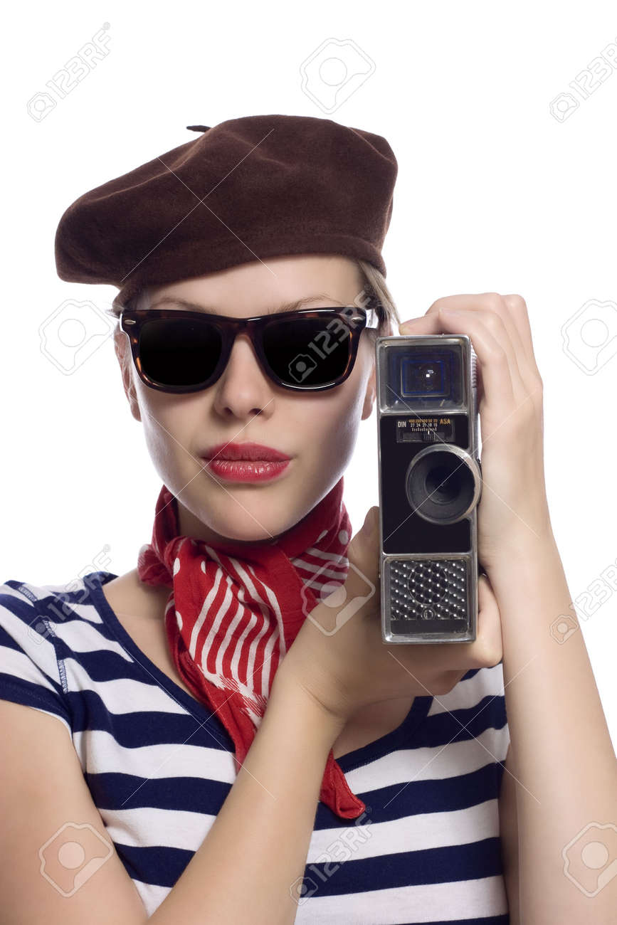 beautiful girl with red bandana, beret and striped shirt in a classic 60s french look holding a vintage 8mm substandard camera Stock Photo - 5046591