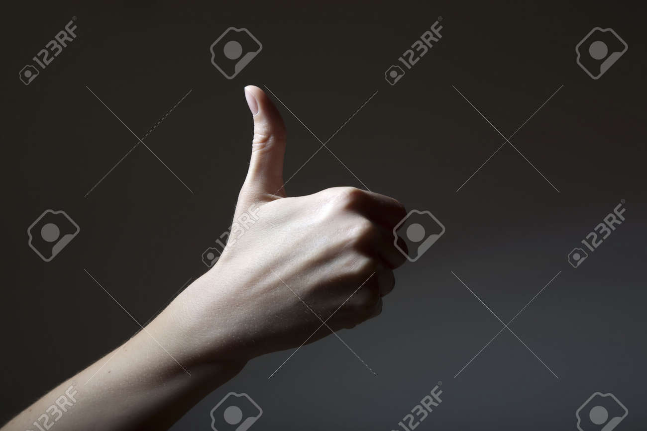 hand counting - one thumb of a girls hand up Stock Photo - 5240811