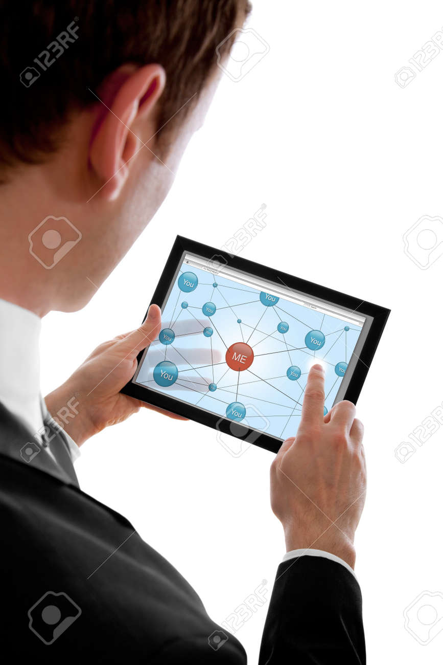 Businessman holding a touchpad pc and surfing in the social network, isolated on white Stock Photo - 7231853