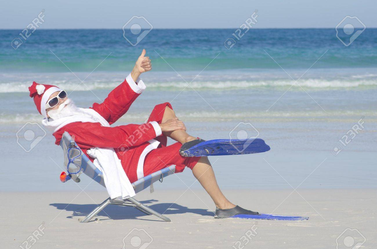 Santa Claus sitting with flippers and snorkel at beach Stock Photo - 16375552