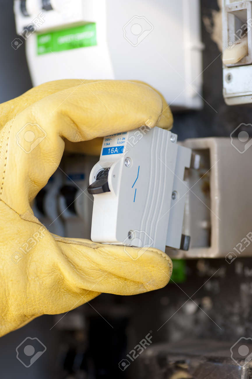 Hand With Protecting Safety Gloves Of Electrician At Electric ...