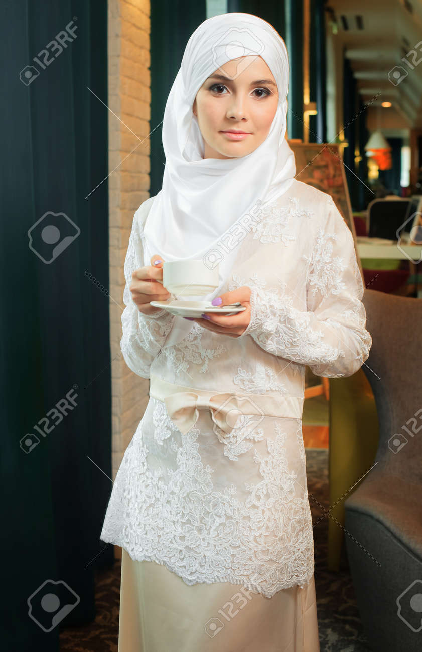 Muslim Woman In A White Wedding Dress With A Cup Of Tea In His ...