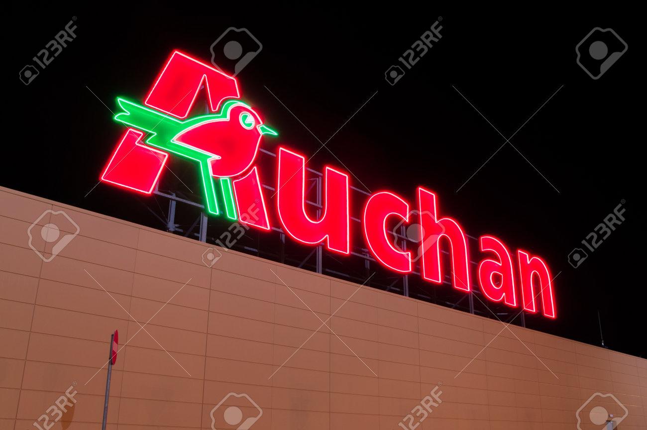 Gdansk, Poland - December 2, 2017: Illuminated Auchan logo at supermarket in Gdansk. Auchan is international supermarket chain. - 91488380
