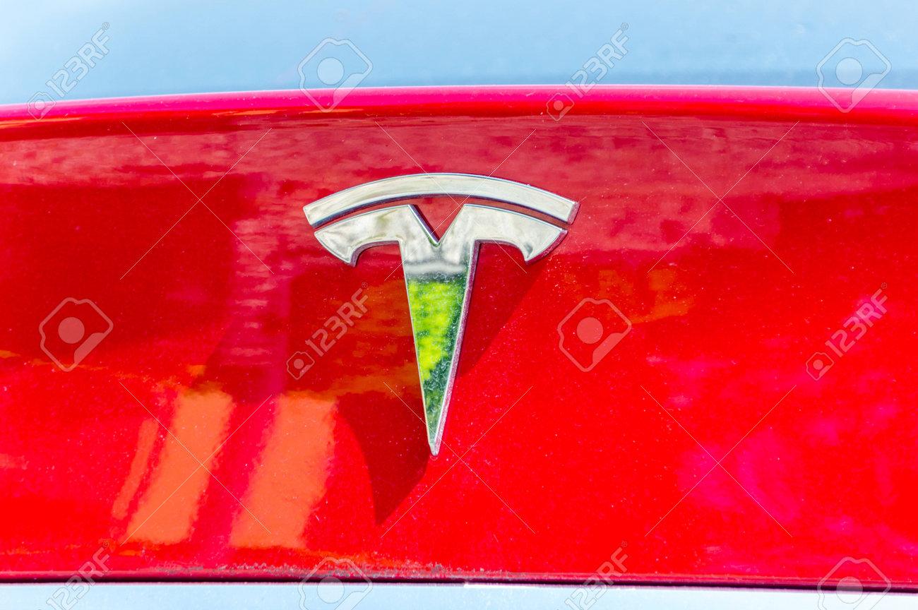 Bergamo, Italy - May 30, 2018: Tesla logo on a red car body