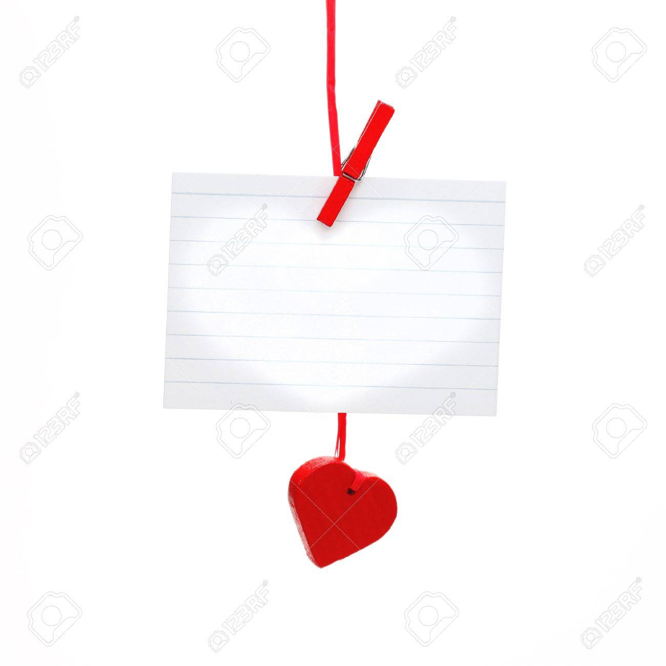 Empty sheet and heart on rope isolated on white. Stock Photo - 11930290