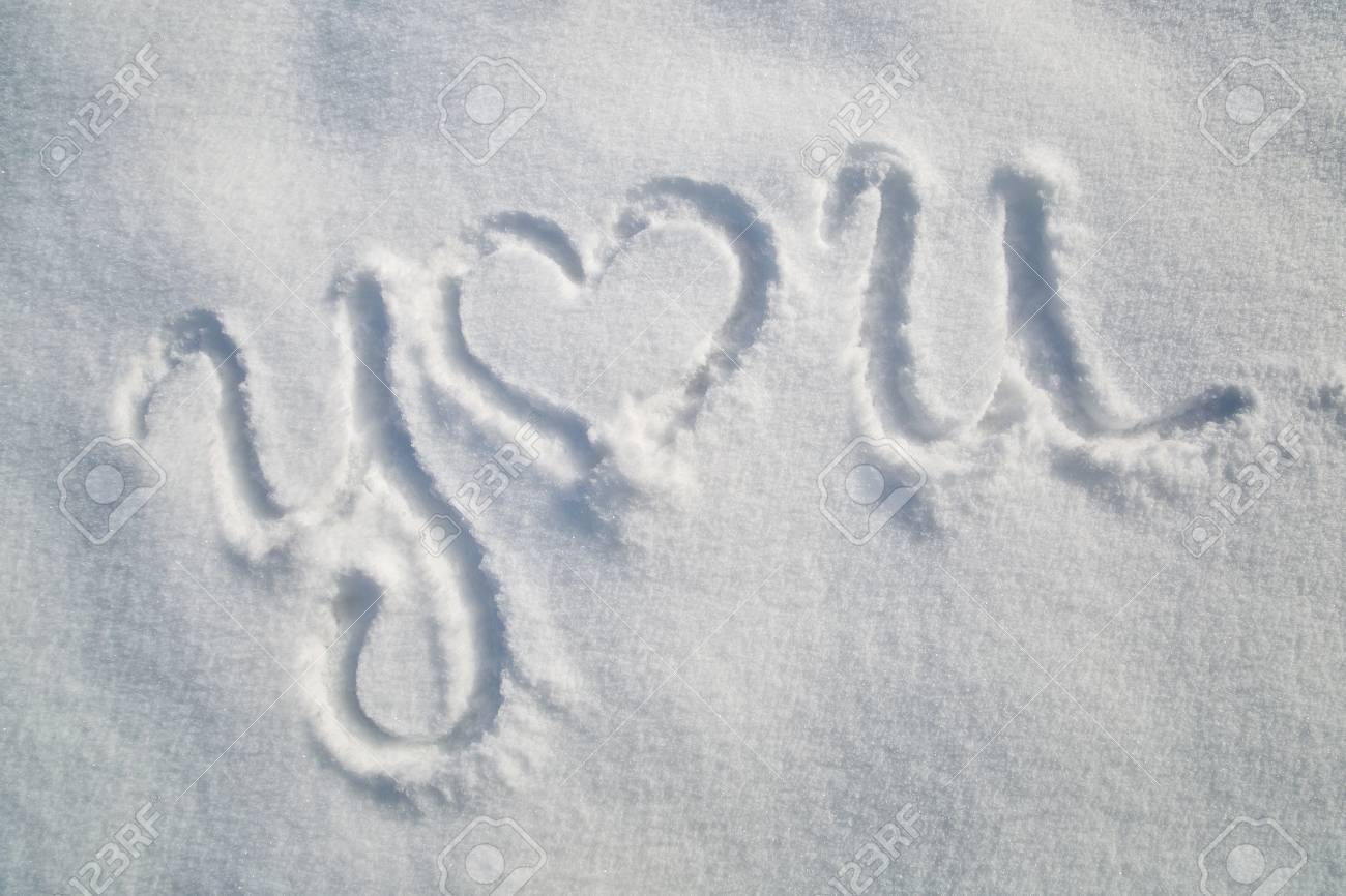 You Word With Heart Symbol Handwriting In The Snow Stock Photo