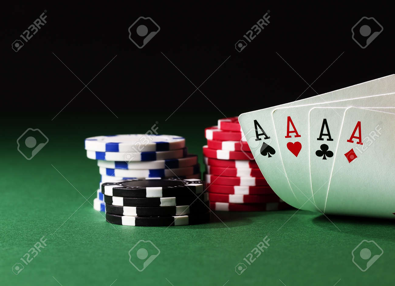 Poker table background - Poker Table Background Four Aces High On Green Table With Chips On Black Background Stock
