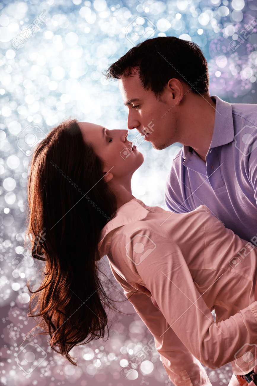 romantic tender couple in front of beautiful light Stock Photo - 13007648
