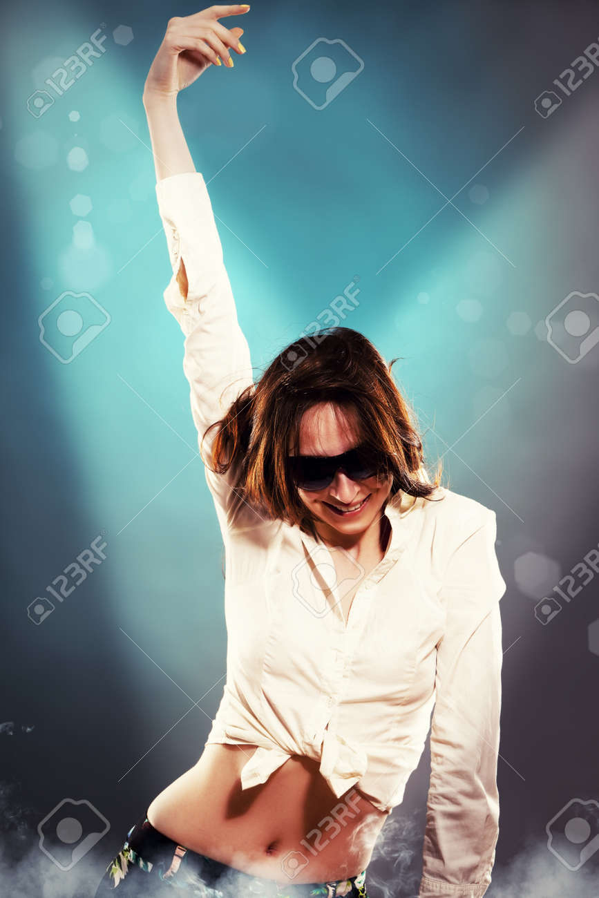 young dancing woman in spotlight Stock Photo - 13007628