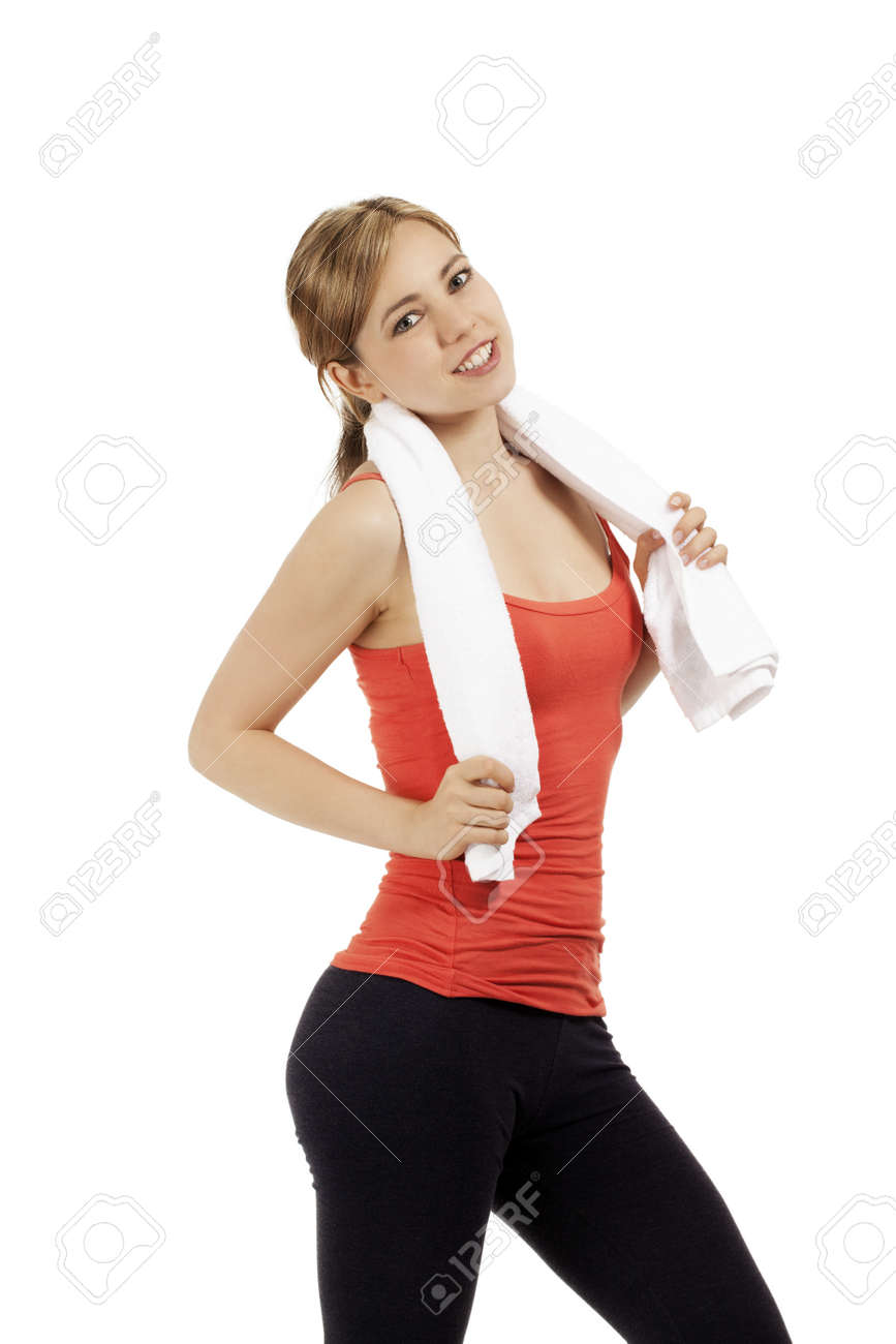 portrait of a happy young fitness woman with a white towel on white background Stock Photo - 14503785