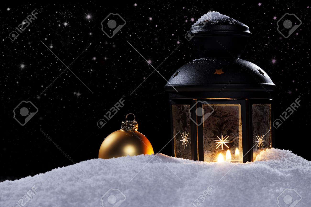 frozen lantern at night with stars and a golden christmas ball in snow Stock Photo - 15220579
