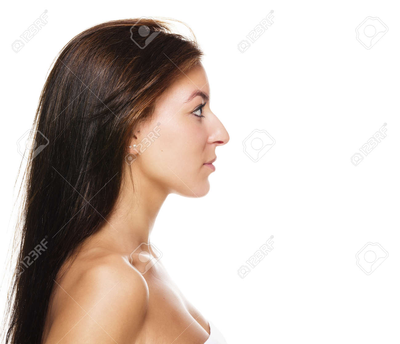 side view of a beautiful brunette woman on white background Stock Photo - 15574580