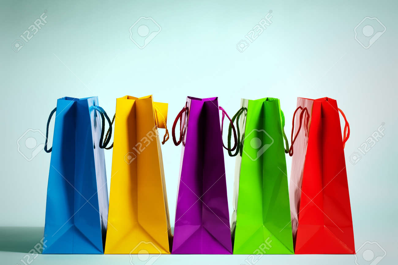 five colorful shopping bags in a row in fashion light Stock Photo - 17858487