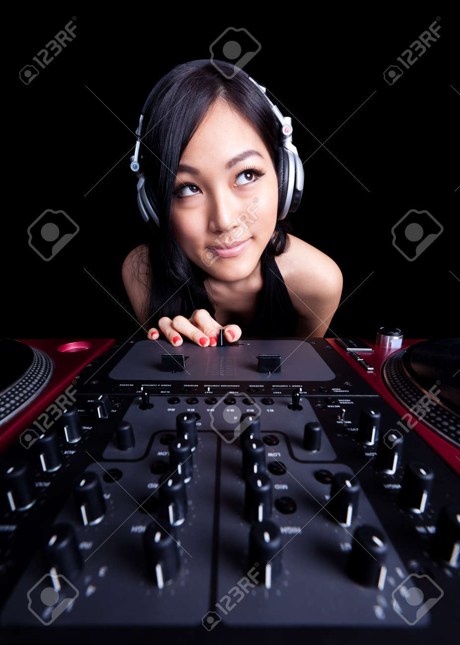 Wide angle shot of a female DJ using the fader. Stock Photo - 9591290