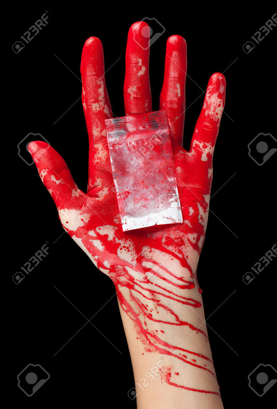 A blood covered hand holding out a bag of white powder isolated on black Stock Photo - 13418365