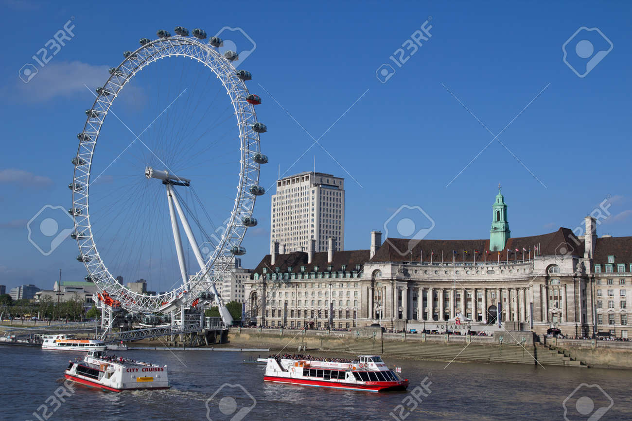 LONDON - MAY 29: The London Eye on the Thames River on May 29, 2011 in the capital city of London.  The London Eye is the most popular attraction of the UK and the tallest Ferris Wheel in Europe at 135 meters (443 feet). Stock Photo - 9743785