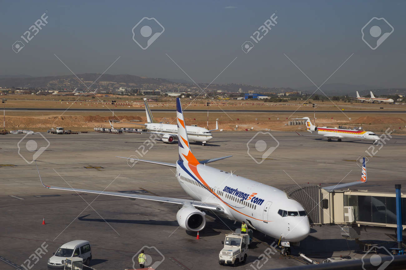 VALENCIA, SPAIN - JULY 19: A Smartwings aircraft at the Valencia, Spain airport on July 19, 2012. Smartwings, based in Prague and owned by Travel Service, is the largest private airline company in the Czech Republic. Stock Photo - 14514597