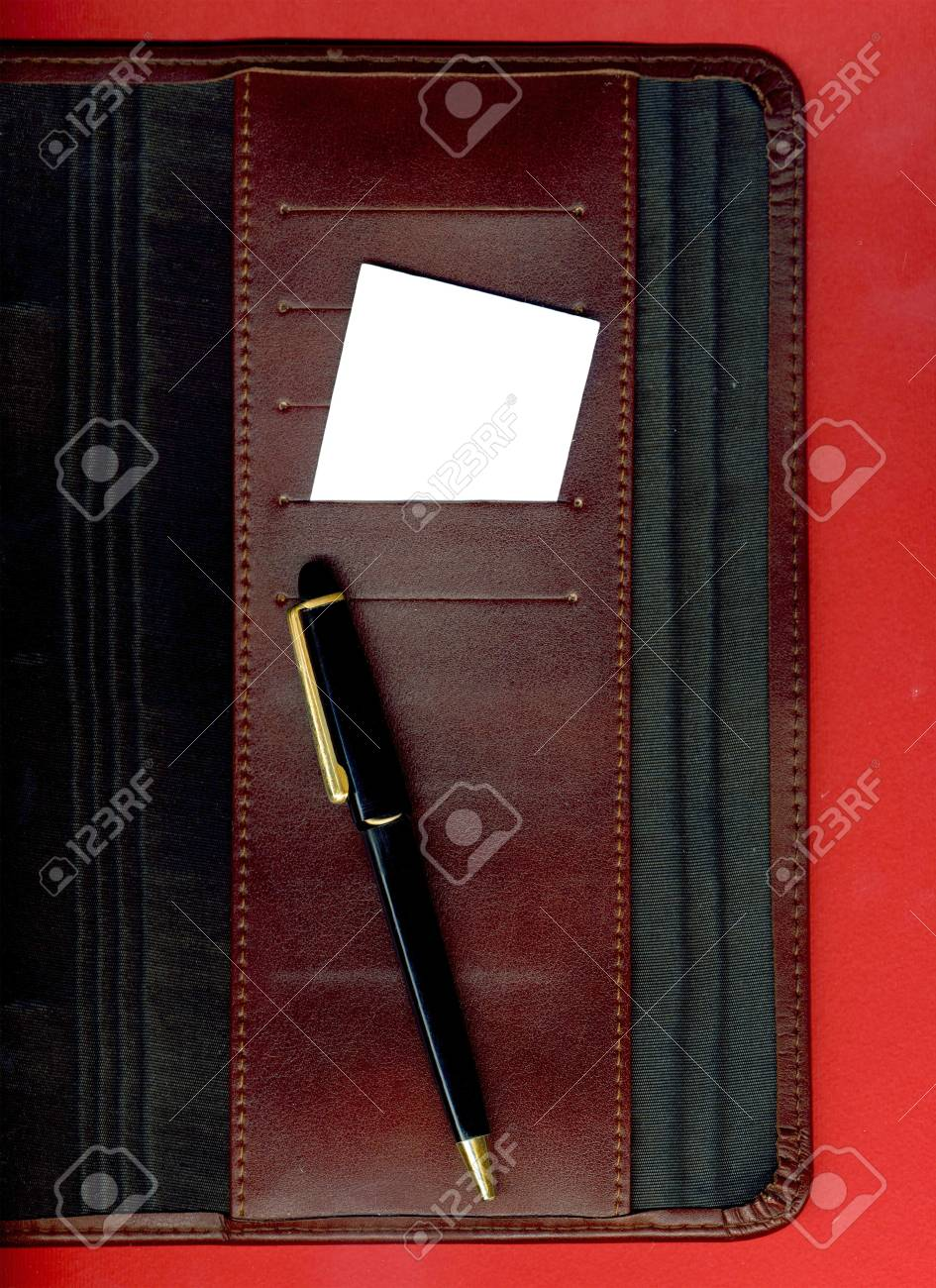 Image of a business card and pen placed on the agenda Stock Photo - 13565350